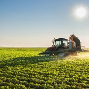 40680787 - tractor spraying soybean field