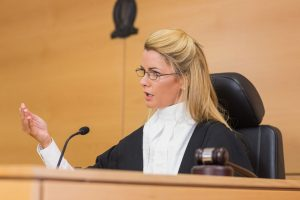 36415549 - stern judge speaking to the court in the court room